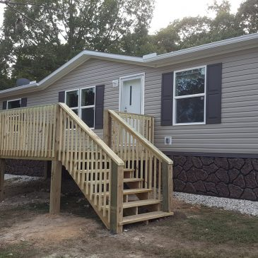 10×16 Deck and Gutters on new Double-wide